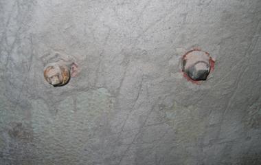 Stuclaag over tegels