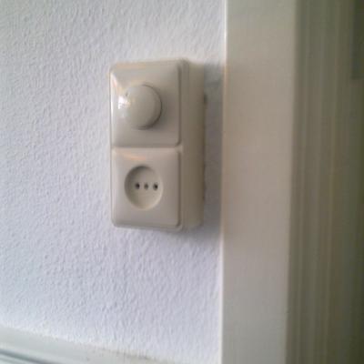 Opbouw dimmer met stopcontact