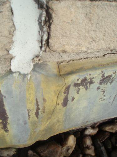 Beroemd Lekkend garagedak door scheur in loodslab CY64