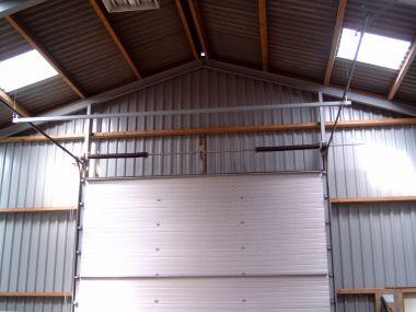 Beroemd Veren van garagedeur spannen DE97