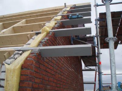 Overstek maken plat dak