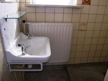 Granieten badkamervloer verwijder