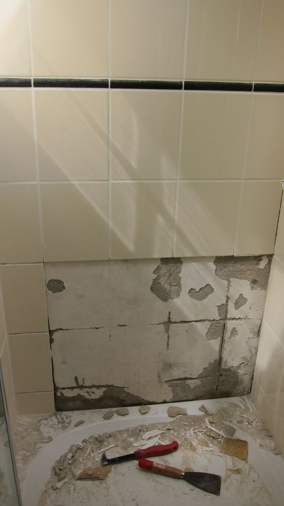 Lekkage via voegen wandtegels douche